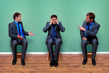 Businessman arguing with himself